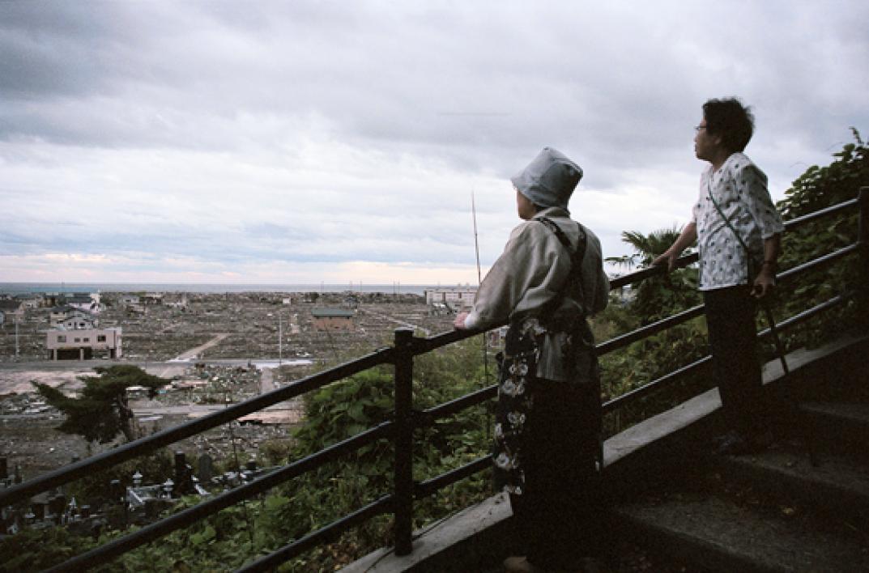 Locals survey the destruction