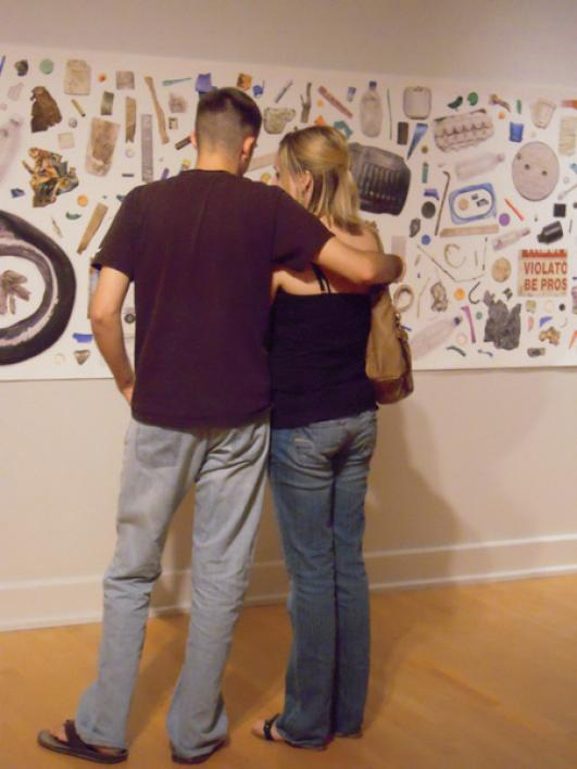 A couple studying Julie Anand's Material Histories in Nowhere to Hide at ASU Art