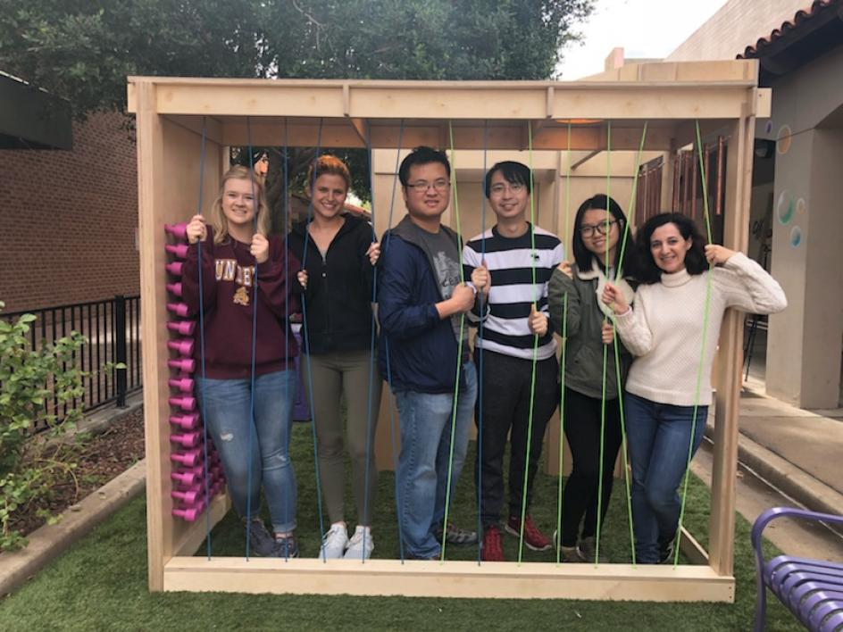 ASU design students pose with the structure they created for the Inter Play installation