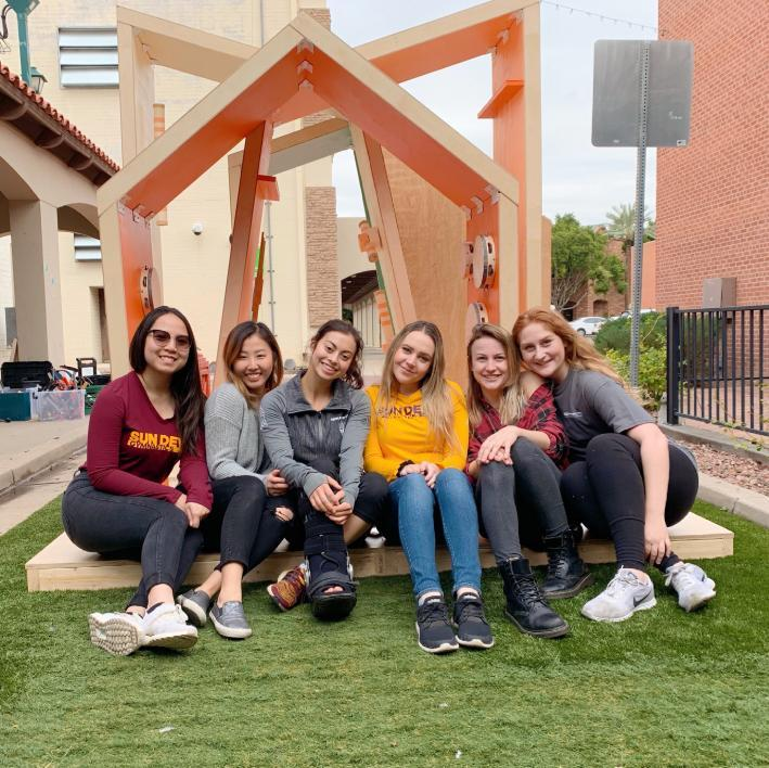 ASU design students pose with a structure they created for the Inter Play installation