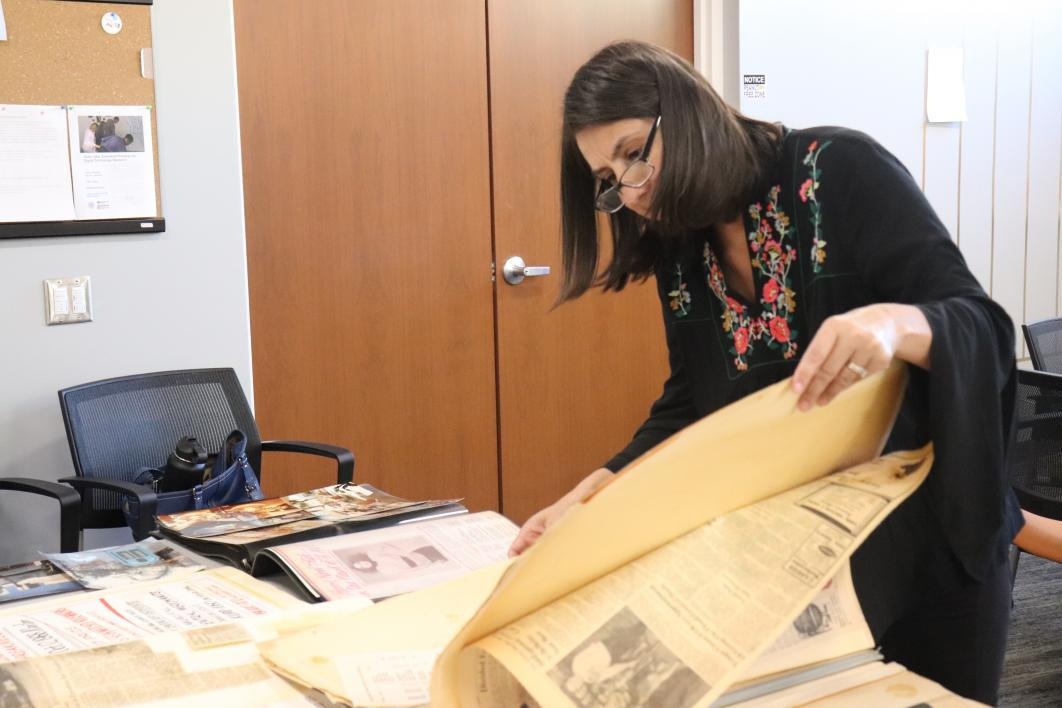 Kristine Navarro looks through historic materials