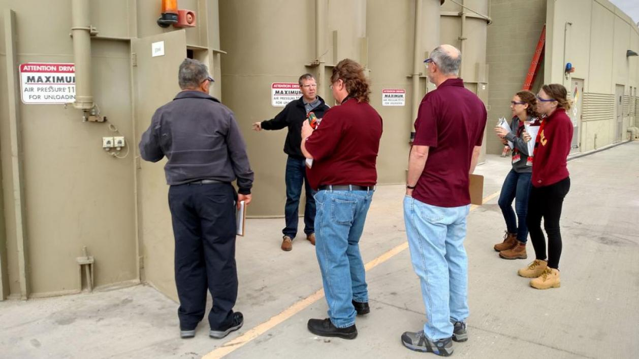 This picture shows members of the Arizona State University Industrial Assessment Center listening to an industry client during a site visit.