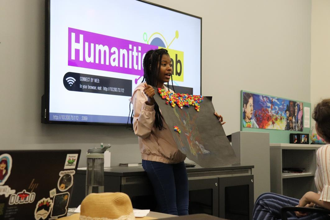 Student Shania Kemp presents her final project to the class.
