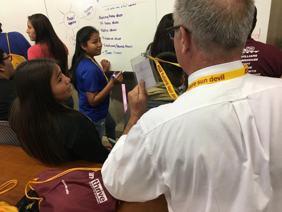 ASU English professor Jim Blasingame checks in with Inspire teams in ASU Changemaker Central