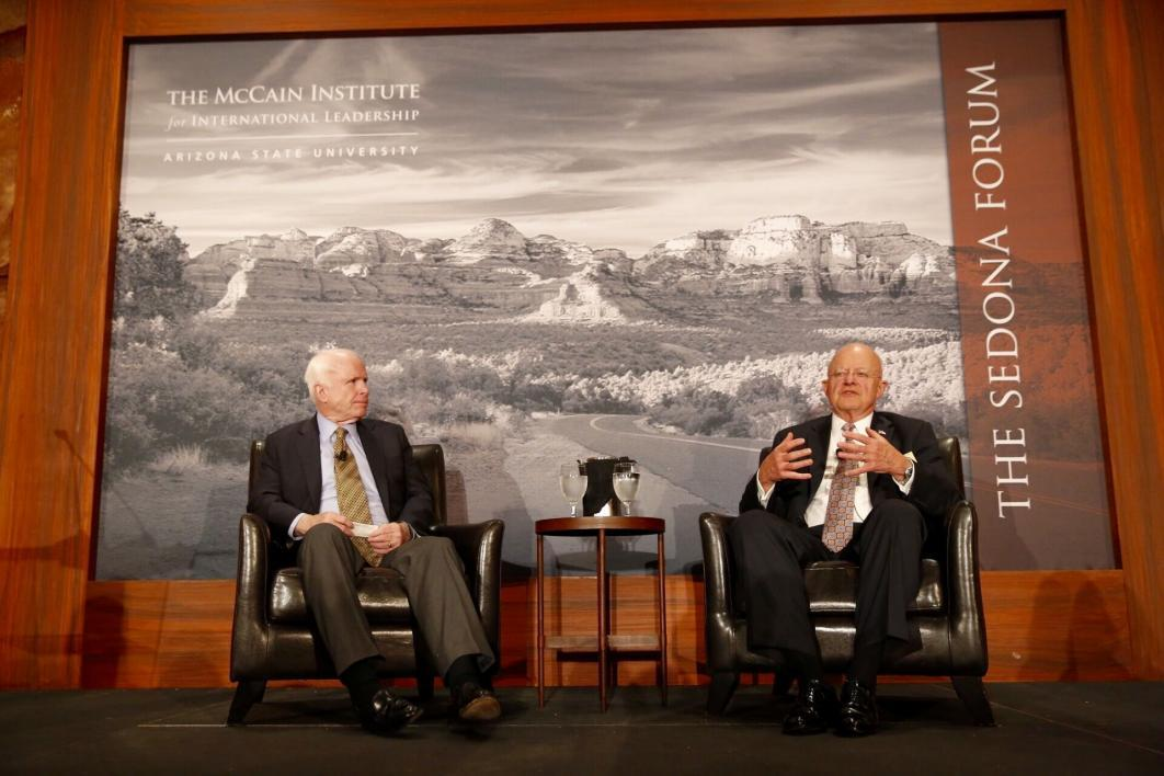 A photograph of Senator John McCain and the Director of National Intelligence James Clapper