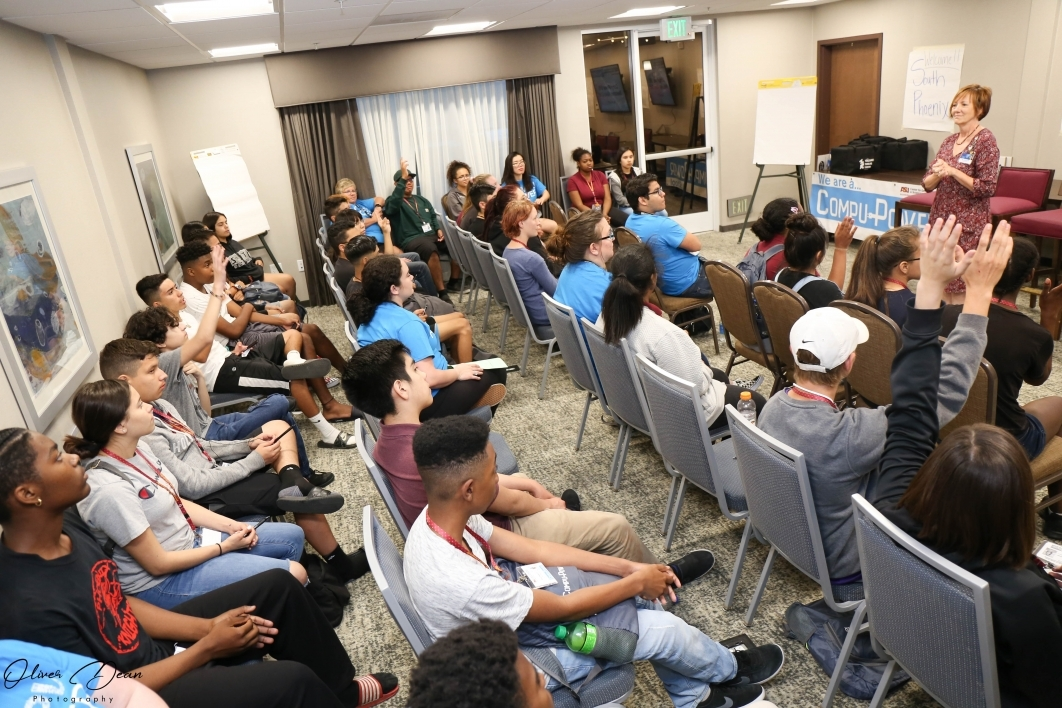 Group of CompuPower students ask questions of presenter during presentation at ASU