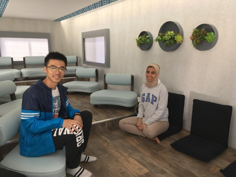 Two students sit inside the M2 Mobile Mindfulness Studio