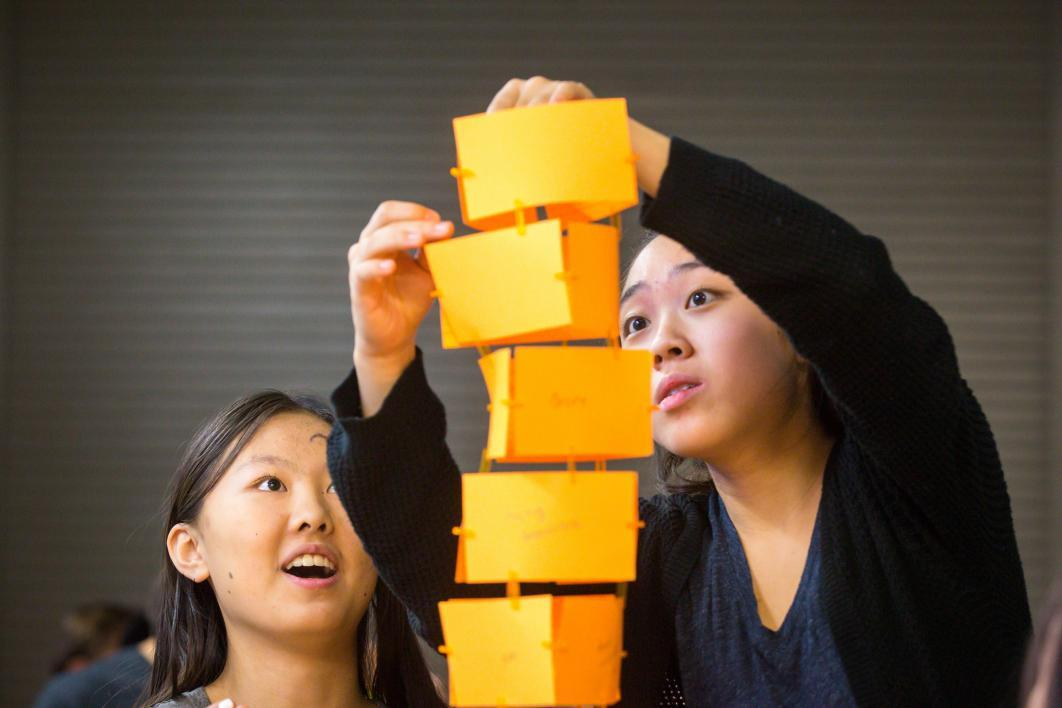 students building paper tower at summer camp