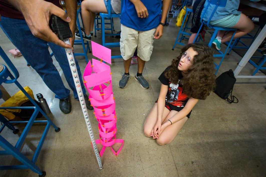 camp counselor measuring paper tower