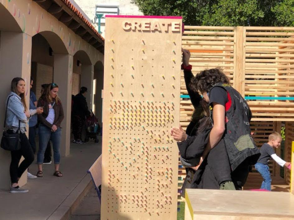 Visitors explore the Inter PLAY installation on display in downtown Mesa.