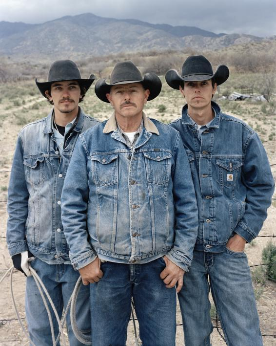 Photo by Pam Golden shows three white men wearing black cowboy hats and denim jackets.