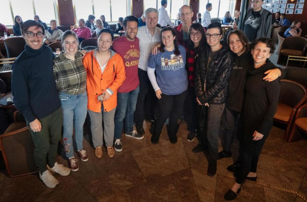 Group of ASU students pictured with former prime minister of Canada aboard a ship in Antarctica