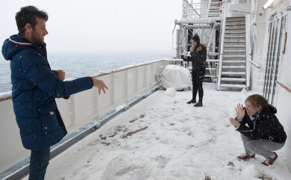 Group of ASU students in a snowball fight aboard the ship in Antarctica