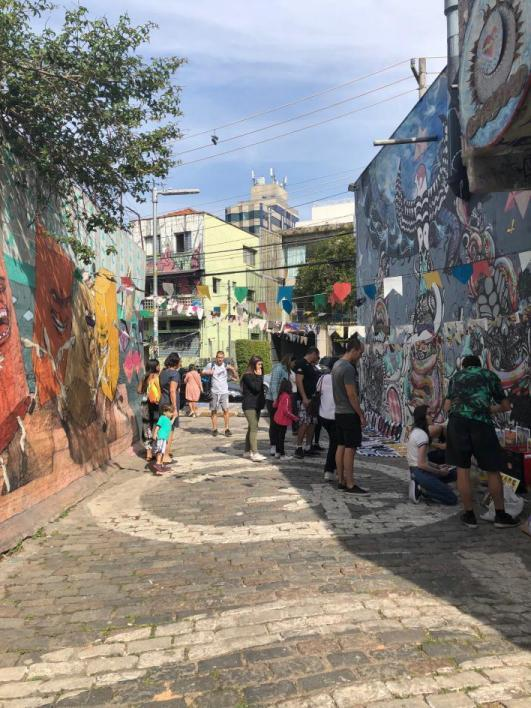 people working on a mural in Brazil