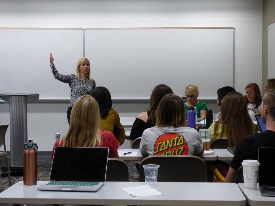 Picture of Karissa Greving Mehall speaking to her class of students
