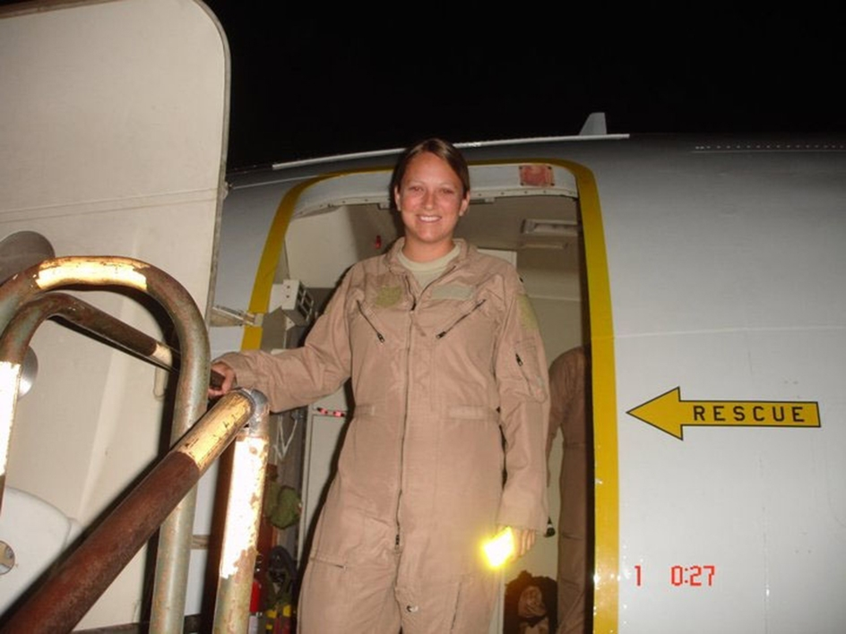 woman stepping out of military plane