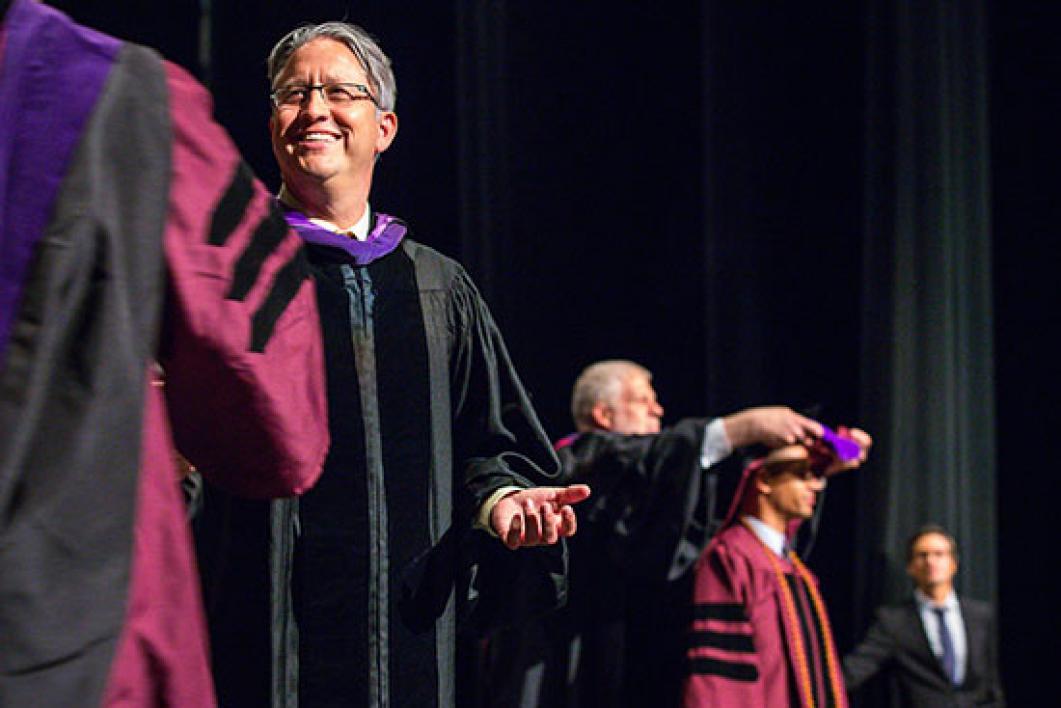 dean greeting graduate at convocation