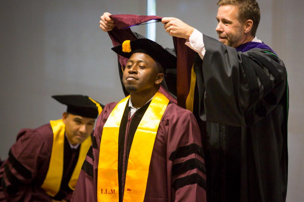 Alpha Muluh gets hooded
