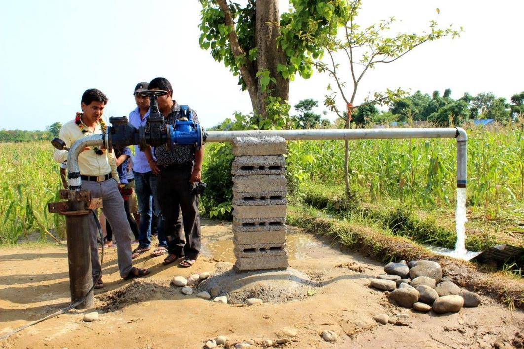 Nepali farmers work on irrigation system
