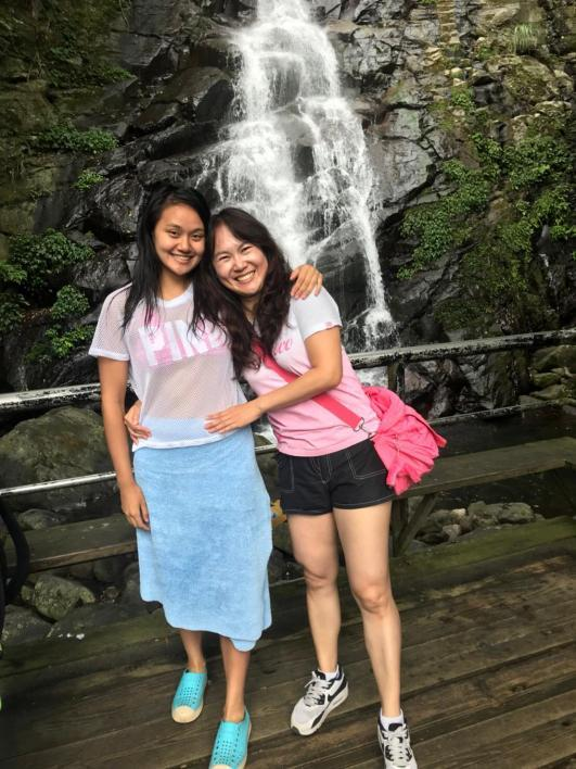 Mother daughter at waterfall