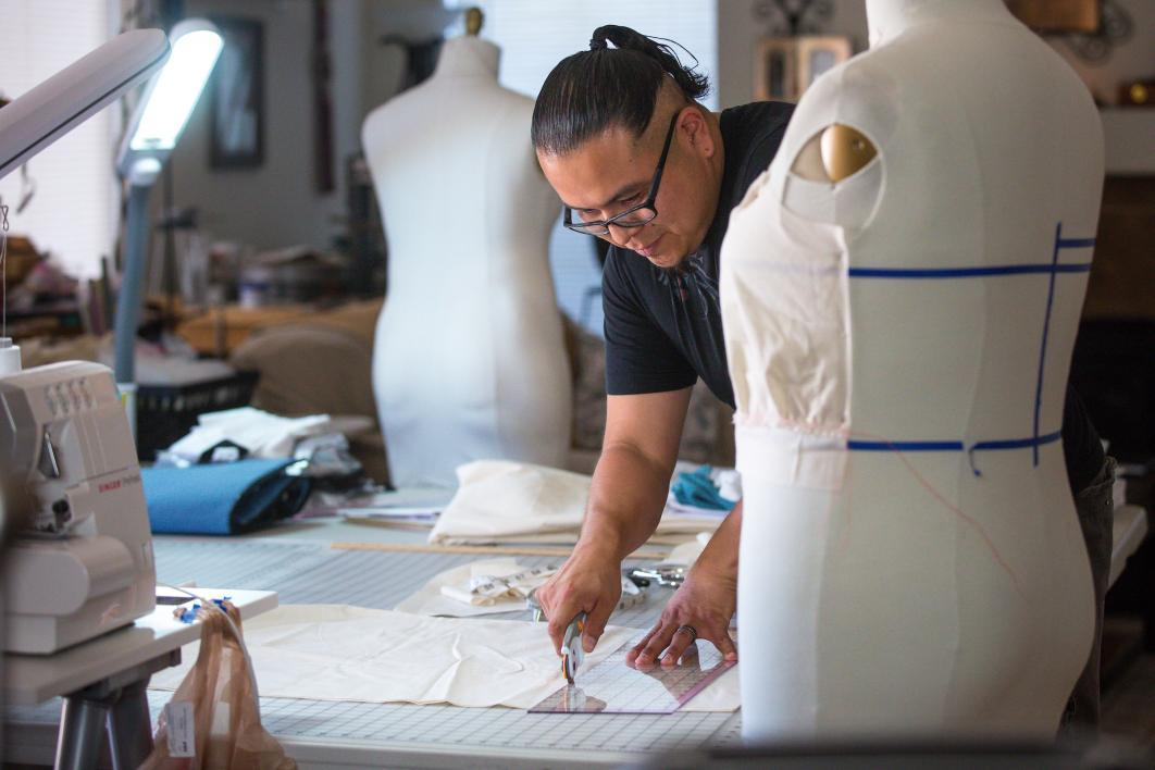 ASU alum and fashion designer Loren Aragon works at his home studio