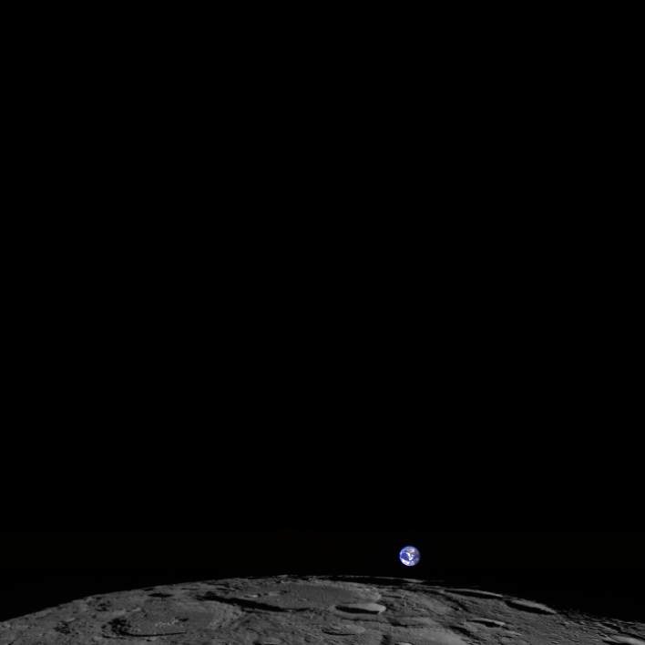 A photo of the Earth rising over the edge of the moon.