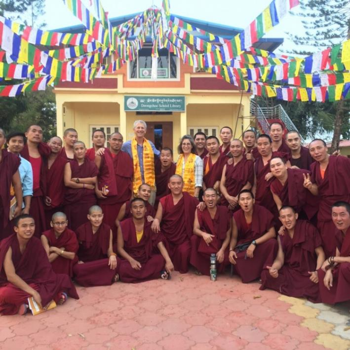 group of Buddhist monks and writing instructors