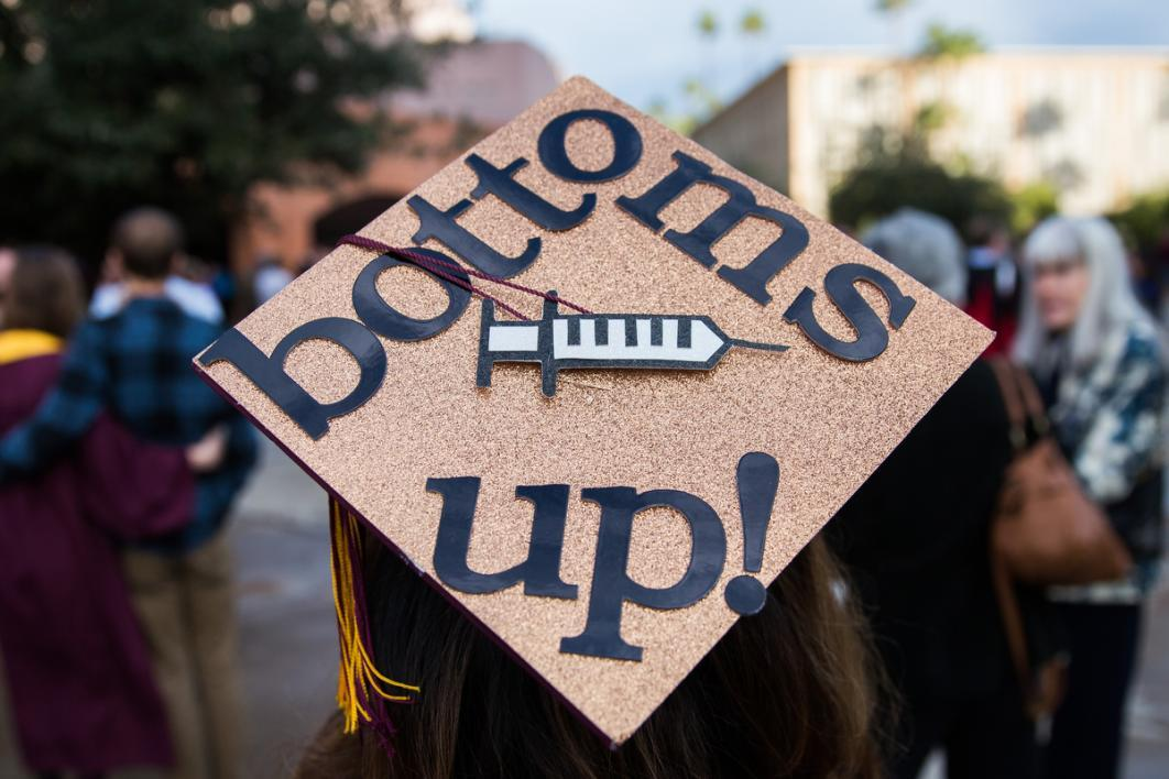 "A graduation cap that says ""Bottoms Up"""