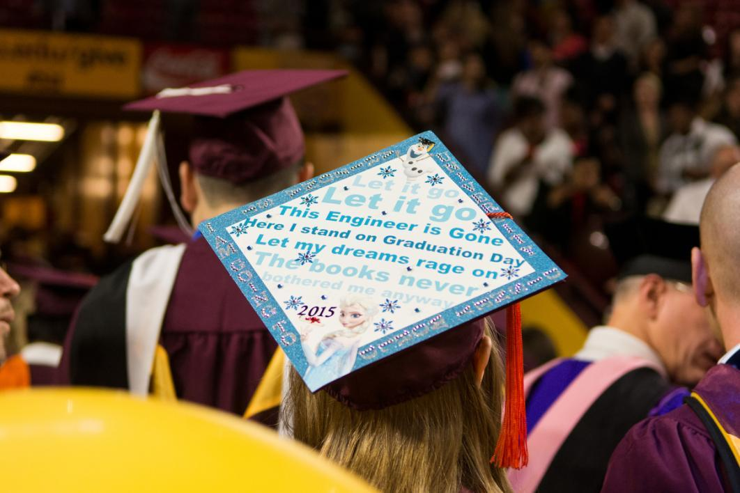 "A graduation cap that says ""Let it go, Let it go, this engineer is gone, here I stand on graduation day"""