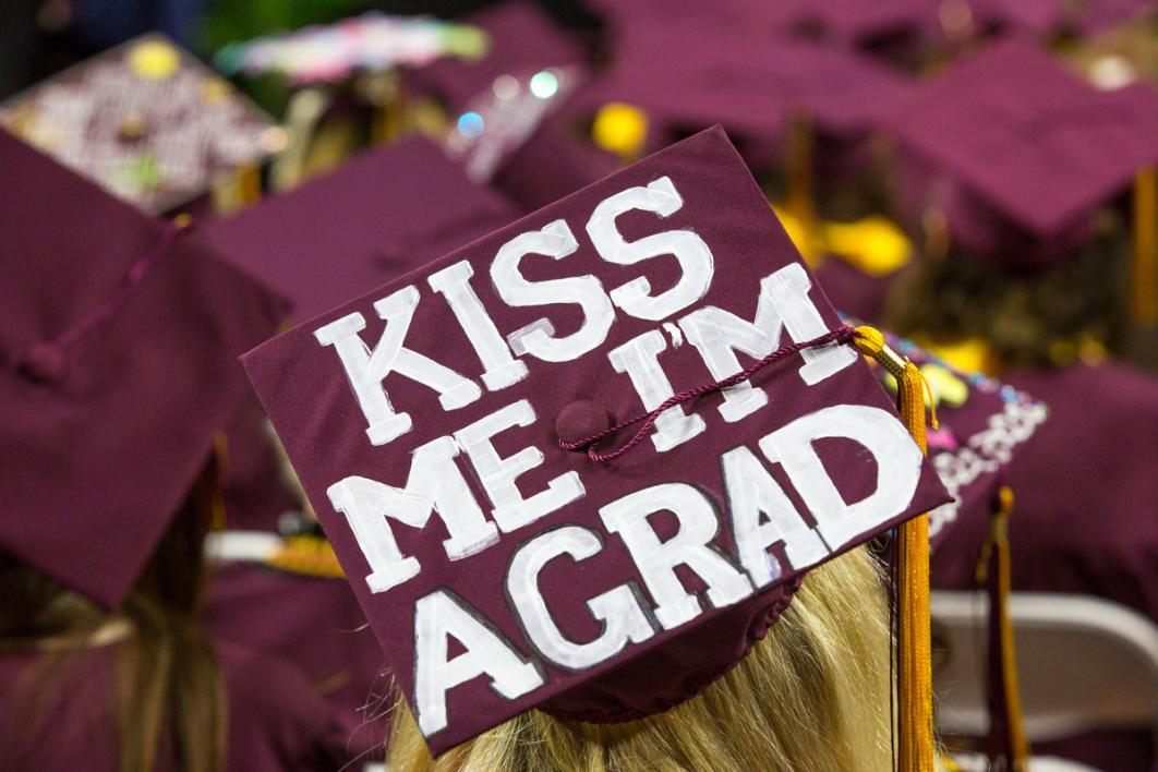 "A graduation cap that says ""Kiss me I'm a grad"""