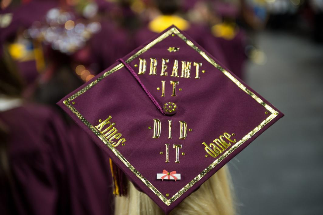 "A graduation cap that says ""Dreamt it, Did it"""