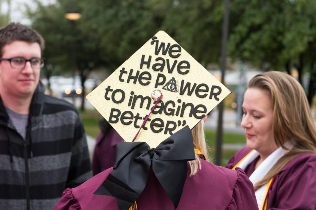 "A graduation cap that says ""We have the power to imagine better"""