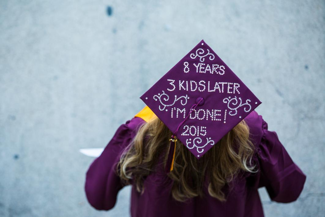 "A graduation cap that says, ""8 years and 3 kids later 2015"""