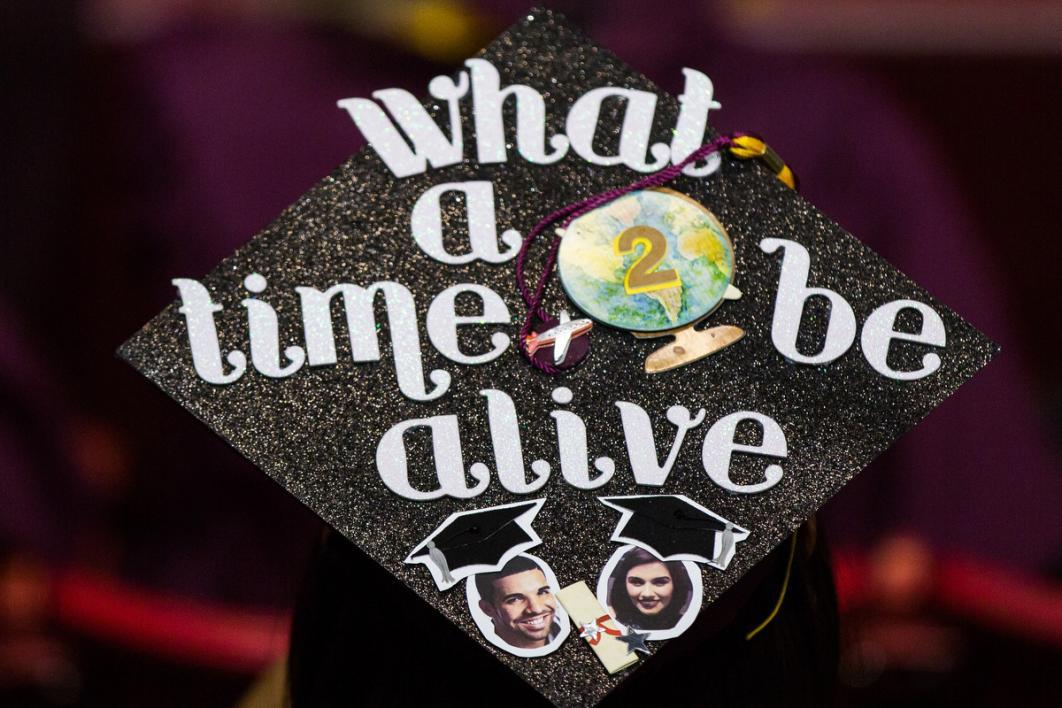 "A graduation caps says ""what a time to be alive"""