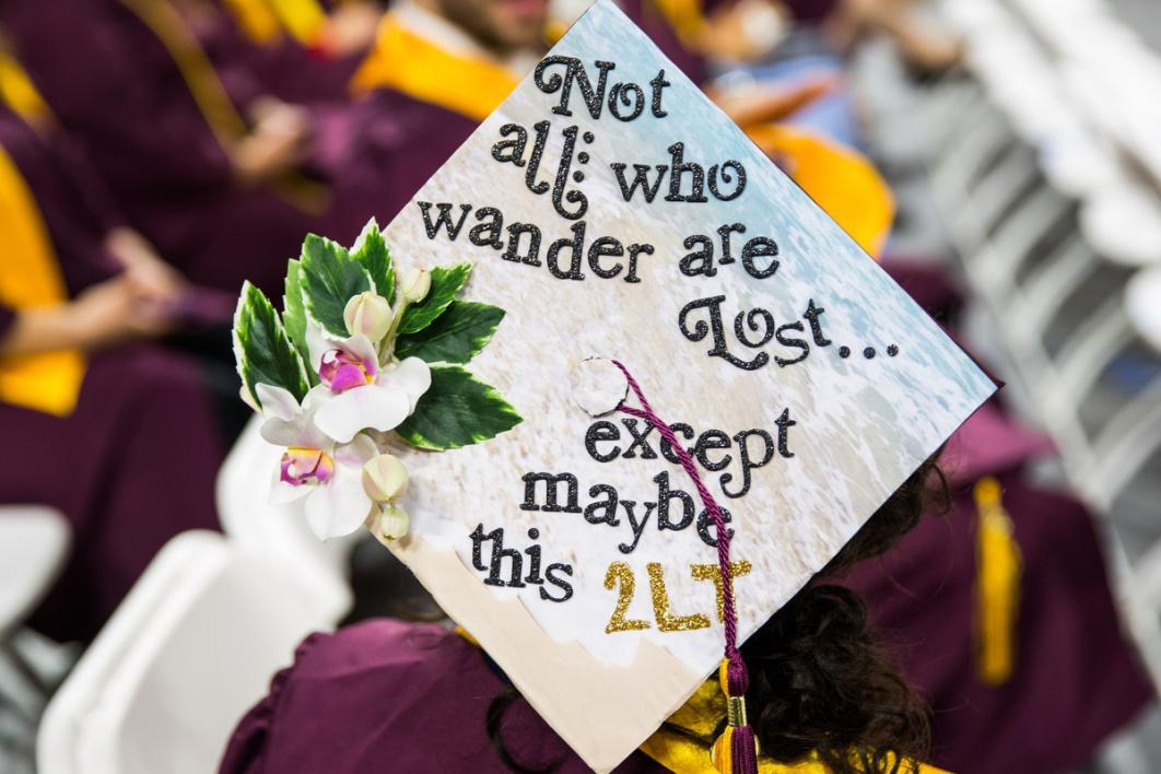 "A graduation cap says, ""Not all who wander are lost except maybe this 2LT"""