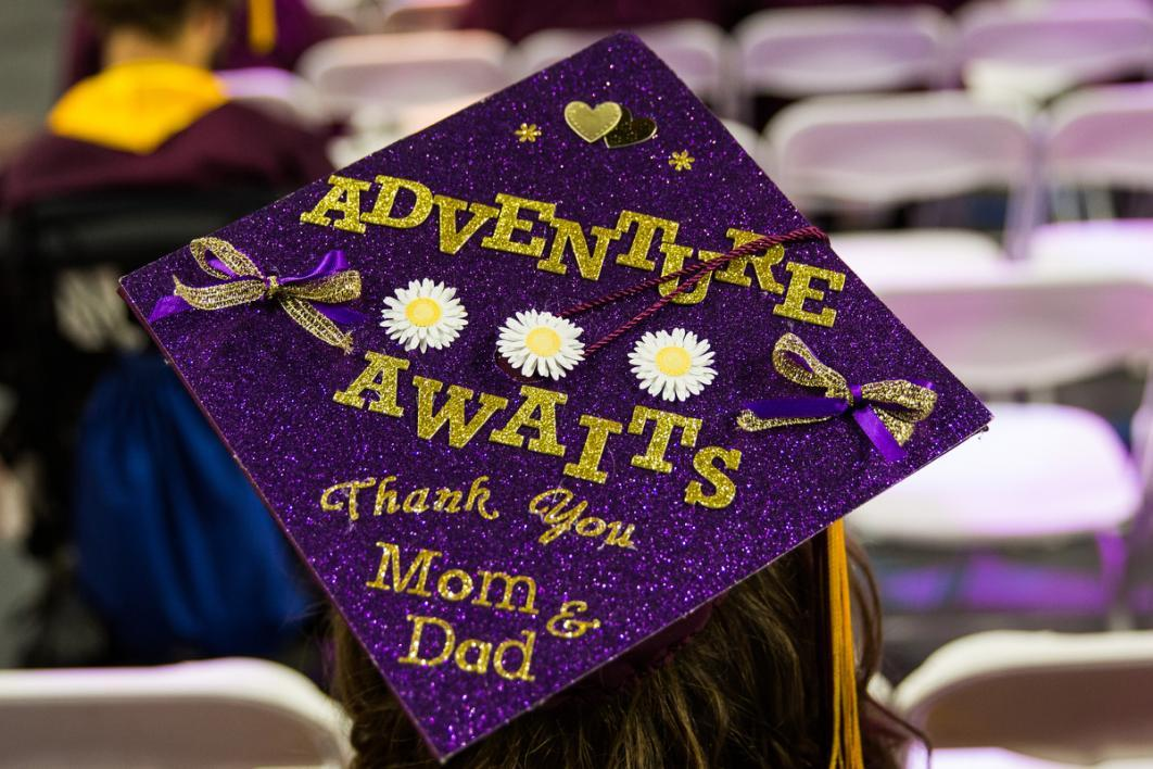"A graduation cap says, ""adventure awaits thank you mom and dad"""