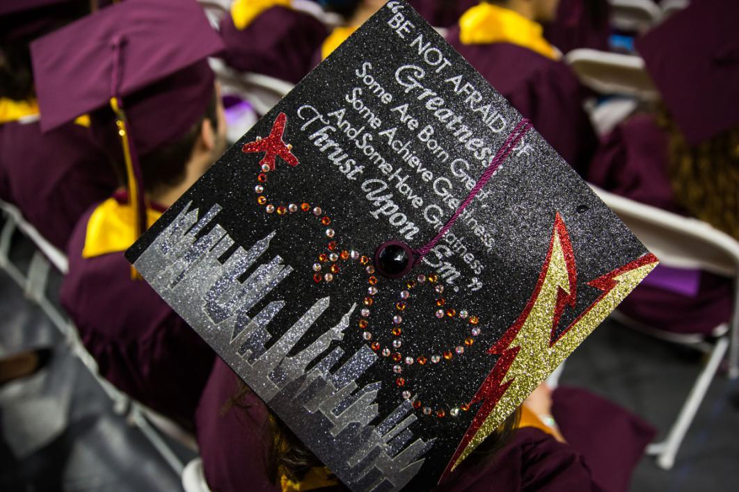 "A graduation cap reads, ""Be not afraid of greatness. Some are born great, some achieve greatness and some have greatness thrust upon them."""