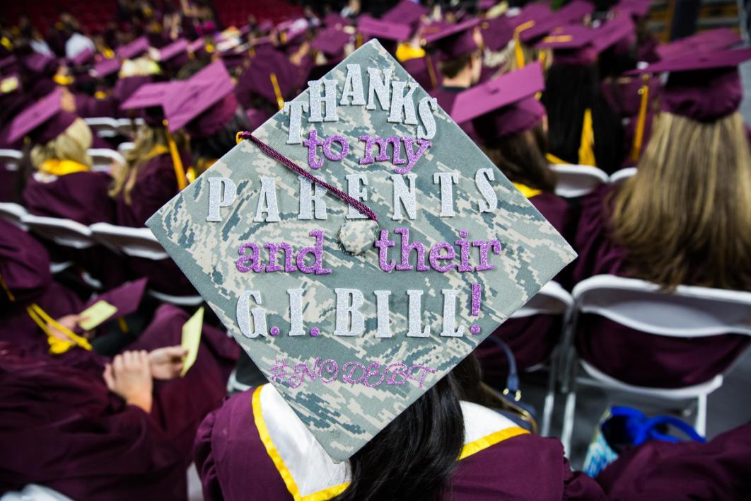 "A graduation cap reads a modified Jay-Z lyric: ""99 problems but a degree ain't one"""
