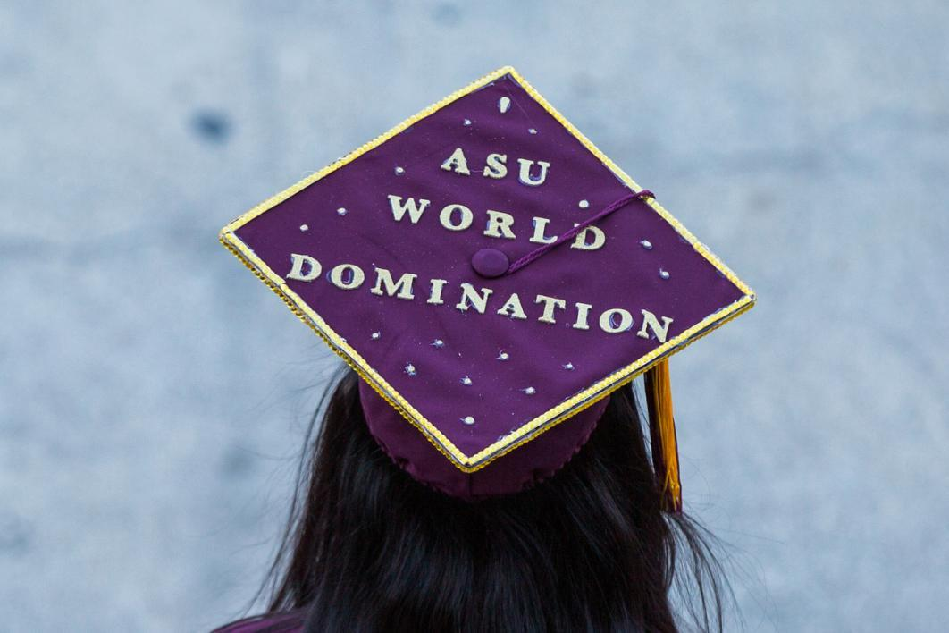 "A graduation cap reads, ""ASU World Domination"""