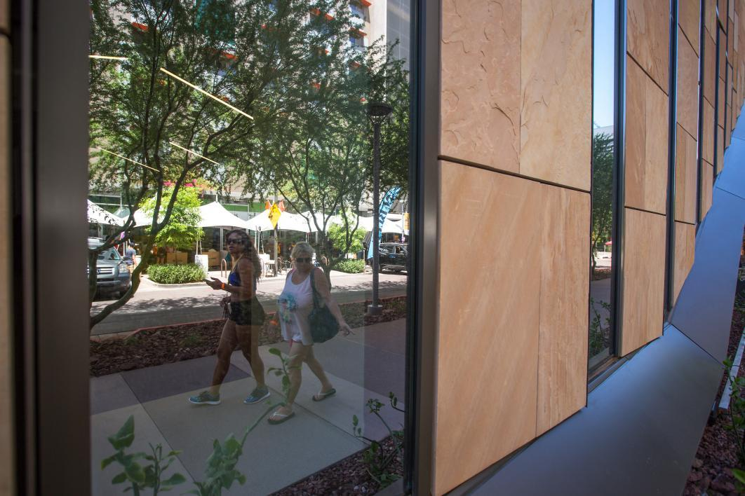 The move-in staging area is reflected in the new law building across the street.