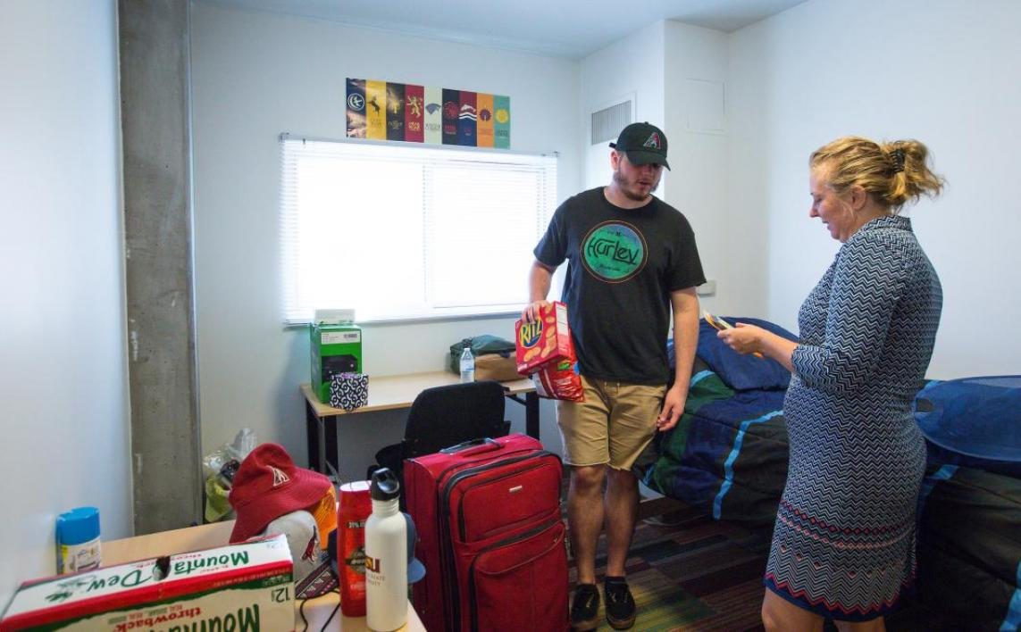 A new student and his mom unpack his things in his downtown Phoenix dorm room.