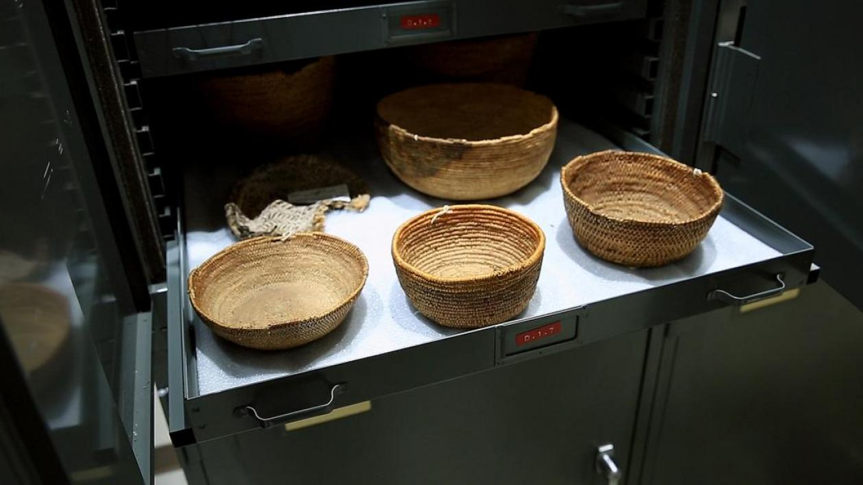 Ancient Native American baskets in a storage drawer