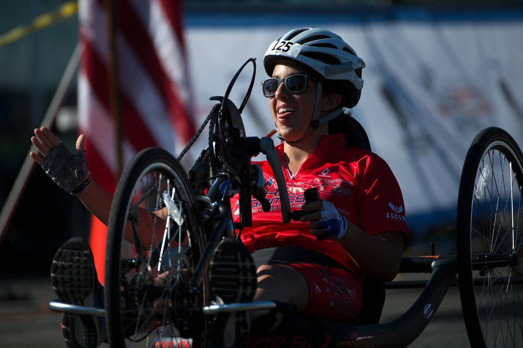 A photo of Nicole Haikalis riding a hand cycle in the 2016 Warrior Games.