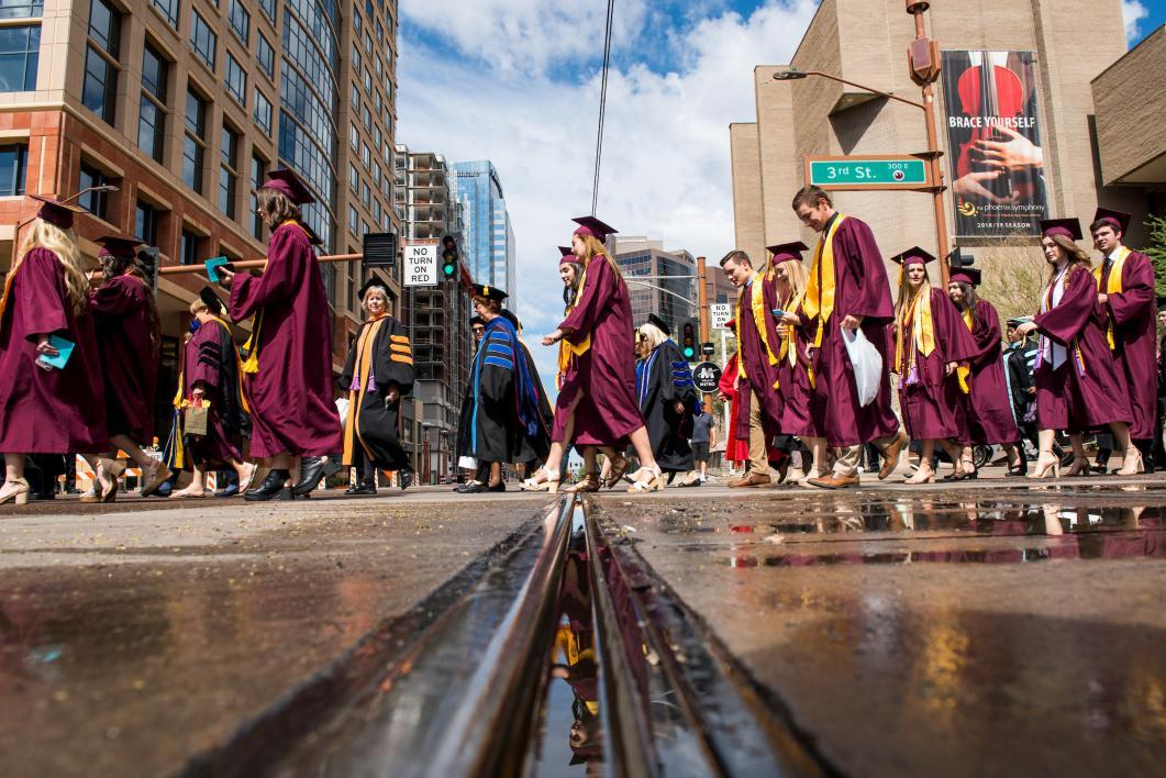 view up at graduates as they walk through downtown Phoenix