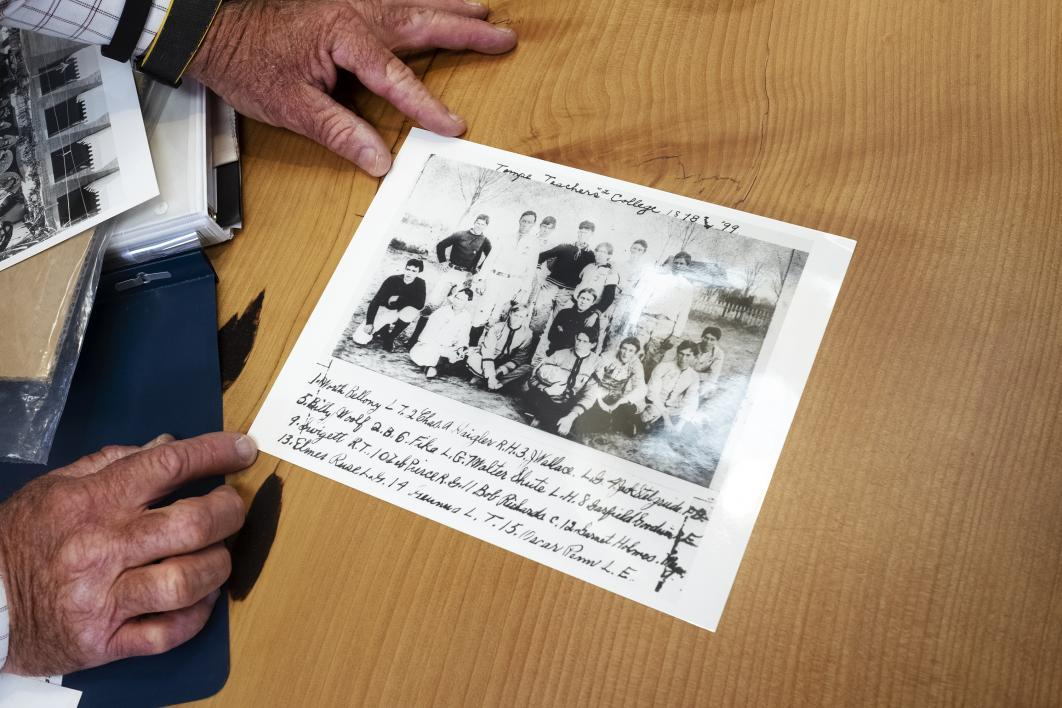 "Arthur ""Art"" Pearce shows a photo of Zebulon and the rest of the Tempe Normal School football team, which he played on until graduating in 1899."