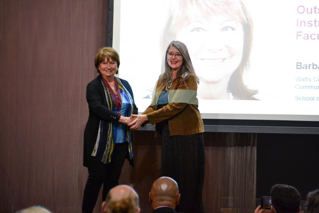 Barbara Klimek accepting her award from Tamara Underiner