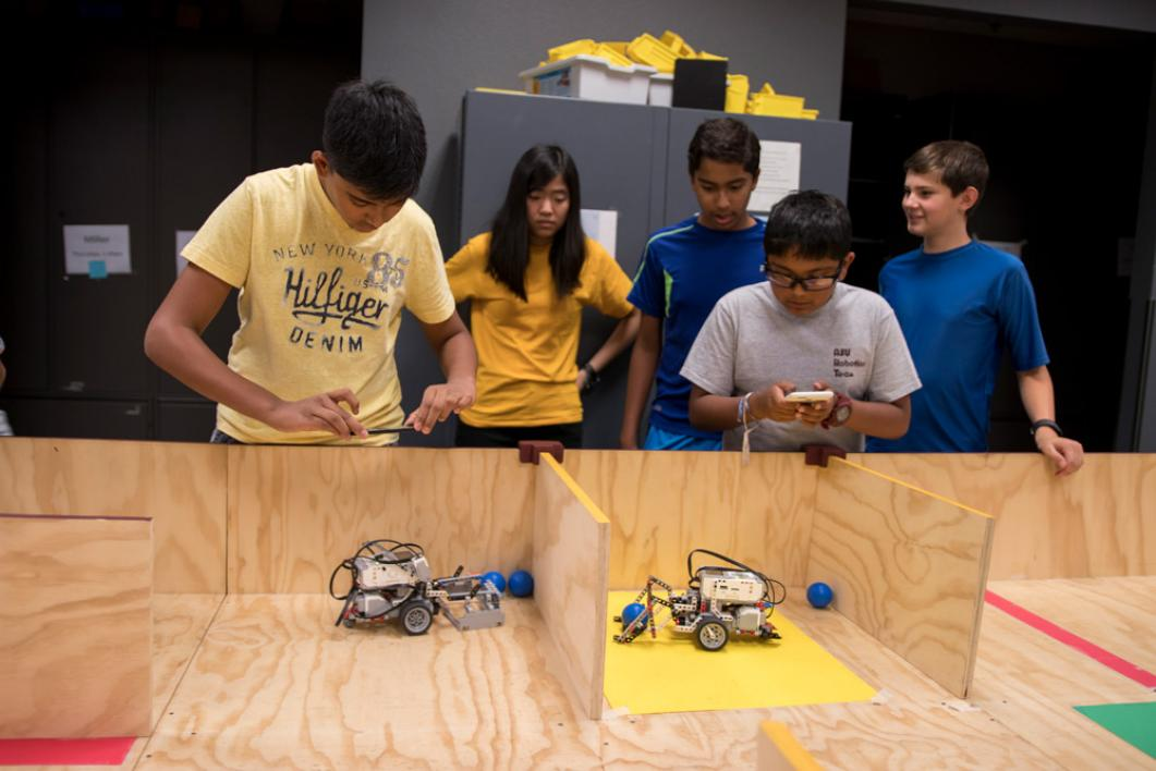 At 7UP Robotics Camp 7th and 8th grade students design and construct robots, learn EV3 robotics programming and participate in a robotics challenge similar to the FIRST® LEGO® League (FLL) Robotics Competition. Photographer: Marco-Alexis Chaira/ASU
