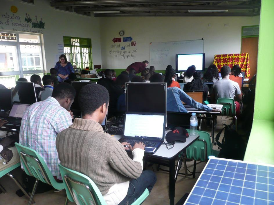 Students in Rwanda use computers in a classroom