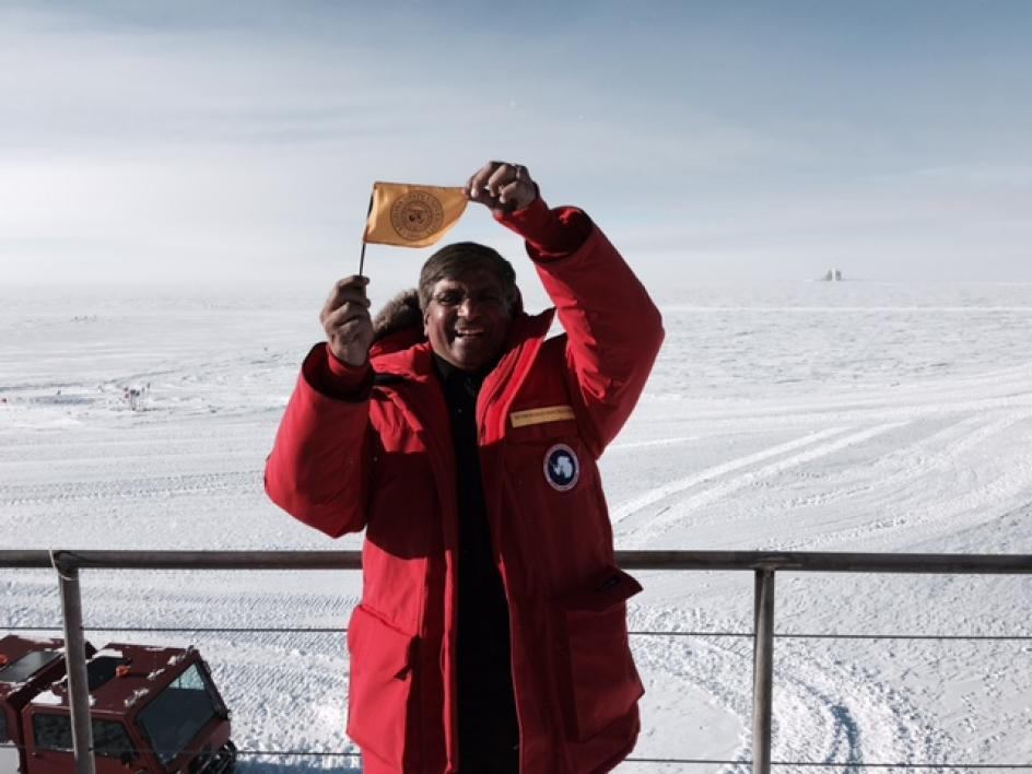 man waving a flag in Antarctica