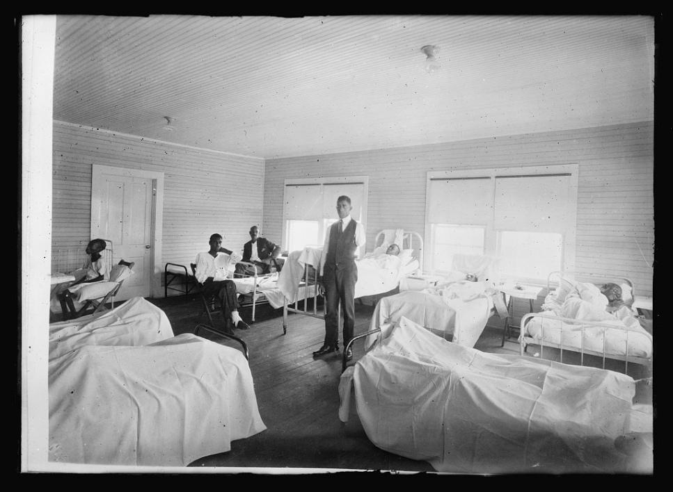 historical photo of patients recovering in a medical room